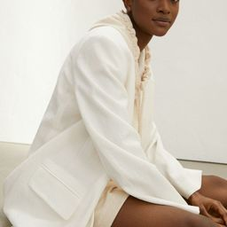 Relaxed-fit, single-breasted blazer in woven fabric made from a Tencel™ lyocell and recycled po...   H&M (US)
