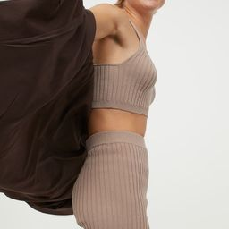 Soft, rib-knit crop top with narrow shoulder straps, V-neck at front, and straight-cut back.   H&M (US)