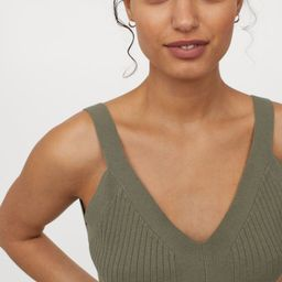 Fitted, sleeveless crop top in a soft, rib-knit LivaEco™ viscose blend. Low-cut V-neck at front...   H&M (US)