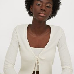 Short cardigan in ribbed jersey with a V-neck, long sleeves, and tie-front fastening.   H&M (US)