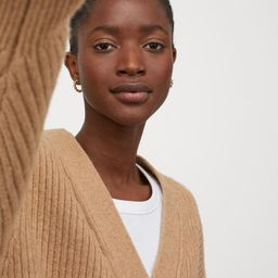 Boxy, long-sleeved cardigan in soft, rib-knit fabric with wool content. V-neck, buttons at front,...   H&M (US)