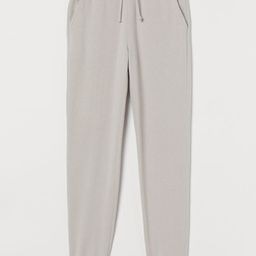 Conscious  Sweatpants with an elasticized drawstring waistband, side pockets, and ribbed hems. S...   H&M (US)