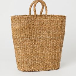 Handmade laundry basket in braided seagrass with two handles at top. Lined. Height 19 3/4 in. Wid...   H&M (US)