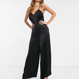 ASOS DESIGN cami strap satin jumpsuit with plunge front in black | ASOS (Global)