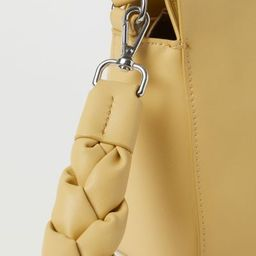 Small shoulder bag in faux leather. Narrow, adjustable shoulder strap, detachable, braided handle... | H&M (US)