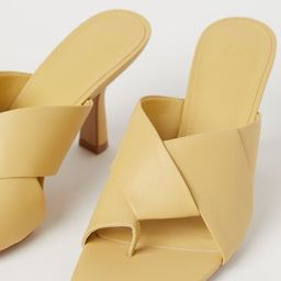 Mules in faux leather with covered heels. Narrow, raw-edge toe post and wide, crossover foot stra... | H&M (US)