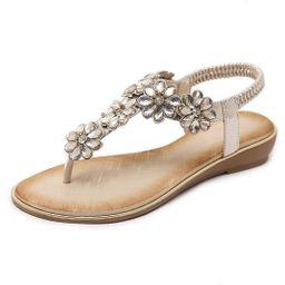 iCKER Women Rhinestone Sandals T-Strap Buckle Bohemian Pearl Crystal Flat Sandals | Amazon (US)