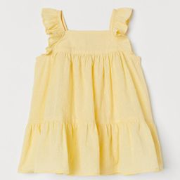 Flared, knee-length dress in airy, woven cotton fabric with ruffles over shoulders. Square neckli...   H&M (US)