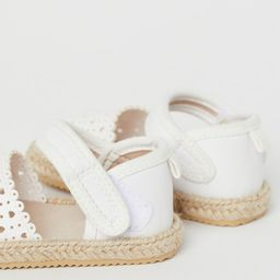 Sandals with braided jute trim around soles. Small loop at back and ankle strap with hook-loop fa...   H&M (US)