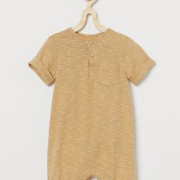 Baby Exclusive. Romper in soft organic cotton slub jersey with a button placket and chest pocket.... | H&M (US)
