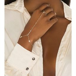 Lili Claspe Anais Hand Chain in Gold from Revolve.com | Revolve Clothing (Global)