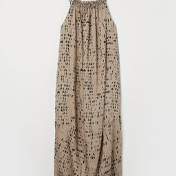 Airy, calf-length dress in a woven lyocell blend with a slight sheen. Narrow, double shoulder str... | H&M (US)