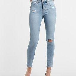 Mid Rise Light Wash Ripped Raw Hem Skinny Jeans | Express