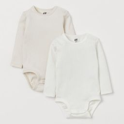 Long-sleeved bodysuits in soft jersey made from organic cotton. Snap fasteners on one shoulder an... | H&M (US)