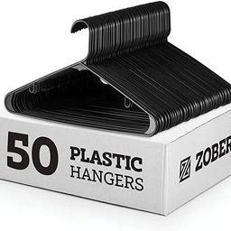 Black Standard Plastic Hangers (50 Pack) Durable Tubular Shirt Hanger Ideal for Laundry & Everyda... | Amazon (US)