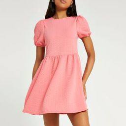Coral textured bow back mini dress | River Island (UK & IE)