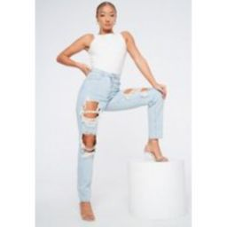 Blue Light Wash Extreme Distressed Mom Jeans | Missguided (US & CA)