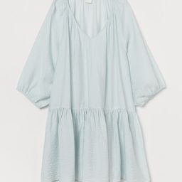 Short dress in airy, woven fabric. Gathered V-neck, wide 3/4-length raglan sleeves with narrow cu...   H&M (US)