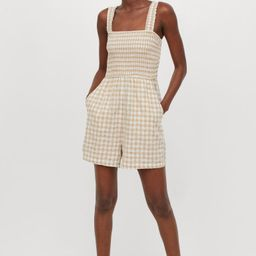 Romper in a woven viscose and cotton blend. Wide, smocked shoulder straps, a smocked bodice, and ...   H&M (US)