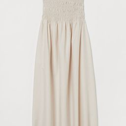 Calf-length dress in woven cotton fabric. Narrow, adjustable, detachable shoulder straps and a sm...   H&M (US)