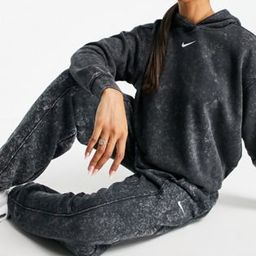 Nike Acid Wash Pack cuffed sweatpants in black | ASOS (Global)