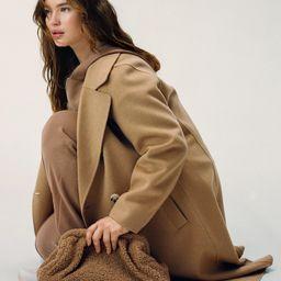 Textured faux-shearling clutch -  Women | Mango USA | MANGO (US)