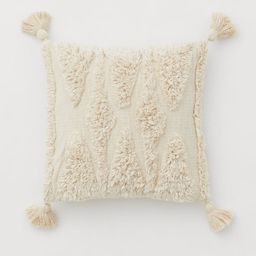 Cushion cover in unbleached cotton canvas. Tufted pattern at front, tassels at corners, and a zip...   H&M (US)
