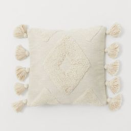 Cushion cover in jacquard-weave cotton fabric with a pattern in short pile. Large tassels at two ...   H&M (US)