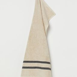 Hand towel in linen and cotton-blend terry. Fringe at one short side and hanger loop at other sho...   H&M (US)