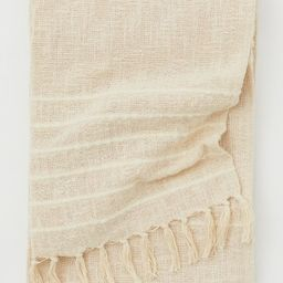 Throw in airy, woven fabric made from an unbleached cotton blend with wool content. Thicker, tone...   H&M (US)
