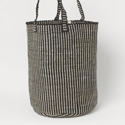 Striped laundry basket in jute with two handles at top. Height 19 3/4 in. Diameter at base 15 3/4...   H&M (US)