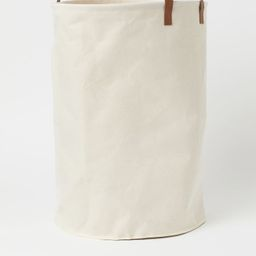 Laundry bag in cotton twill with faux leather details. Two handles and concealed plastic strip at...   H&M (US)