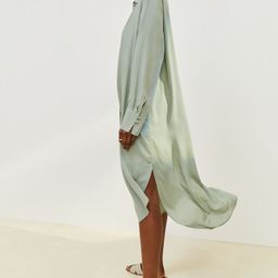 Relaxed-fit, calf-length dress in an airy, woven lyocell blend. Low-cut V-neck and pleat at front...   H&M (US)