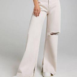 Bershka wide leg pants with knee rip in beige   ASOS (Global)