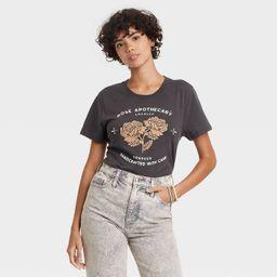 Women's Schitt's Creek Rose Apothecary Short Sleeve Graphic T-Shirt - Black Wash | Target