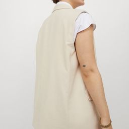 Oversized, sleeveless jacket in woven fabric. Notched lapels, button at front, and welt front poc... | H&M (US)
