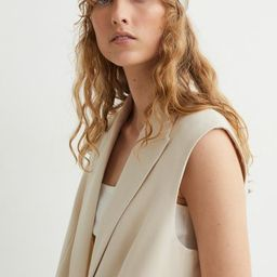 Straight-cut, sleeveless jacket in woven fabric with pointed lapels. One button at front, welt fr...   H&M (US)