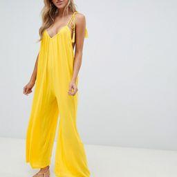 ASOS DESIGN crinkle low back beach jumpsuit with tassel ties in yellow - Yellow | ASOS US