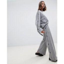 Cheap Monday Margin tape side wide leg joggers - Grey melange | ASOS BE