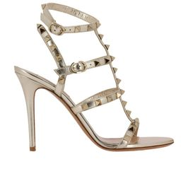 Heeled Sandals Valentino Rockstud Sandals In Laminated Leather With Ankle Strap And Metal Studs | Giglio.com
