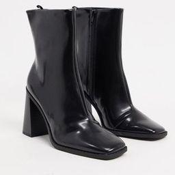 Monki Robbie vegan-friendly leather heeled boot in black | ASOS (Global)