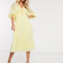 ASOS DESIGN pleated dobby midi dress with lace up front in yellow   ASOS (Global)