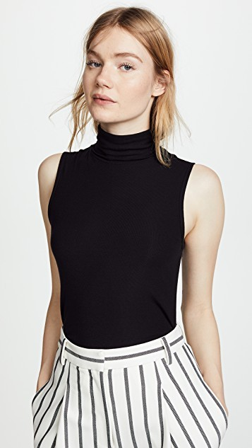 1a407c92ea How to Wear a Sleeveless Sweater — LCB STYLE