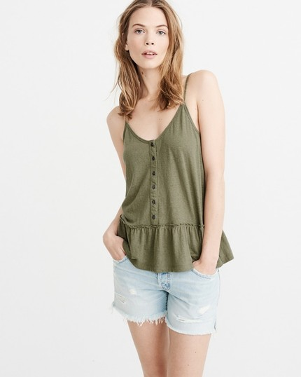 2521ceb432d14 Best peplum tank! On clearance for only  14! I own it in this olive color    also the stripes!
